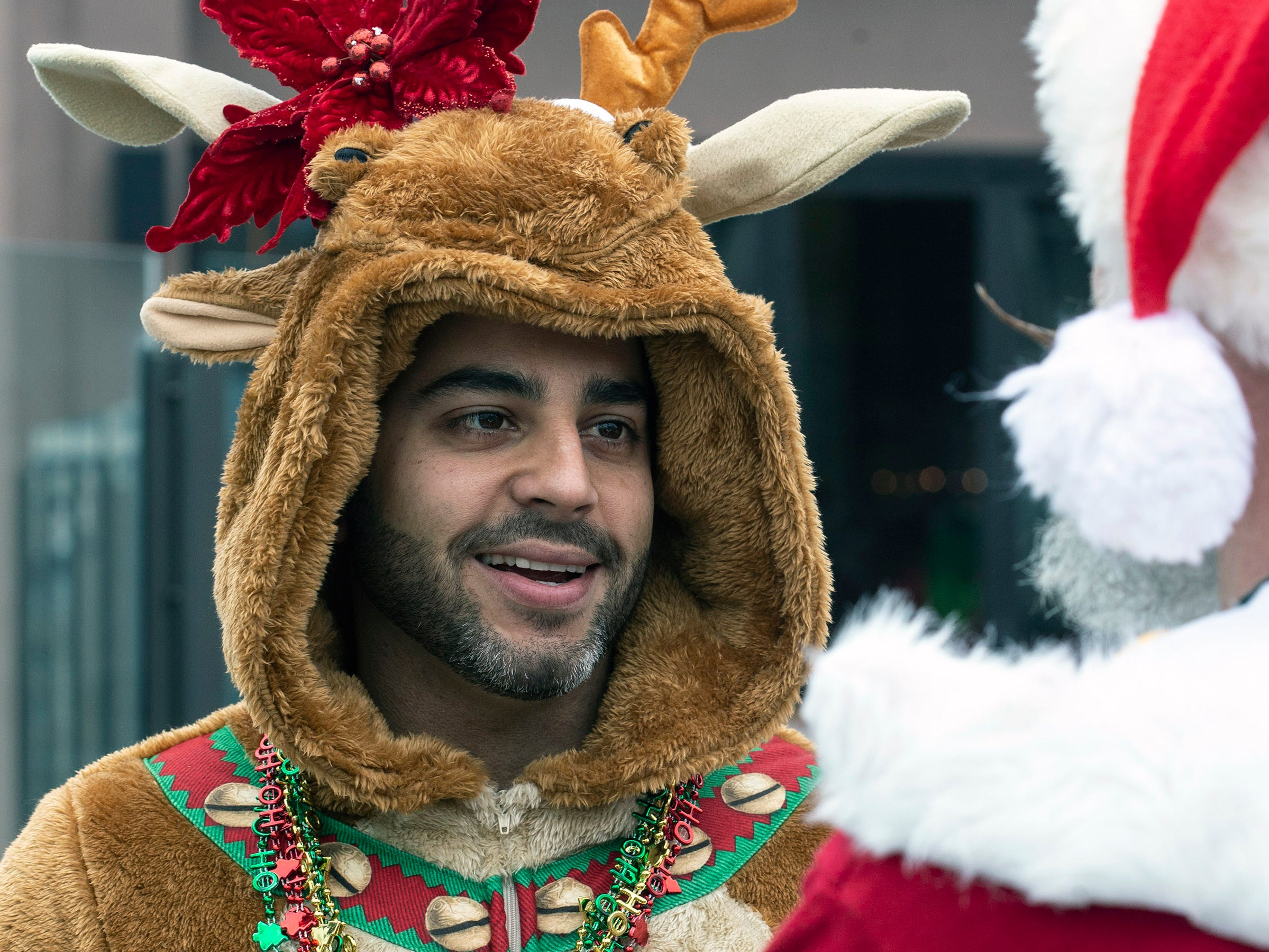 Alain Benitez donned the reindeer costume for SantaCon on Saturday. 12/8/18
