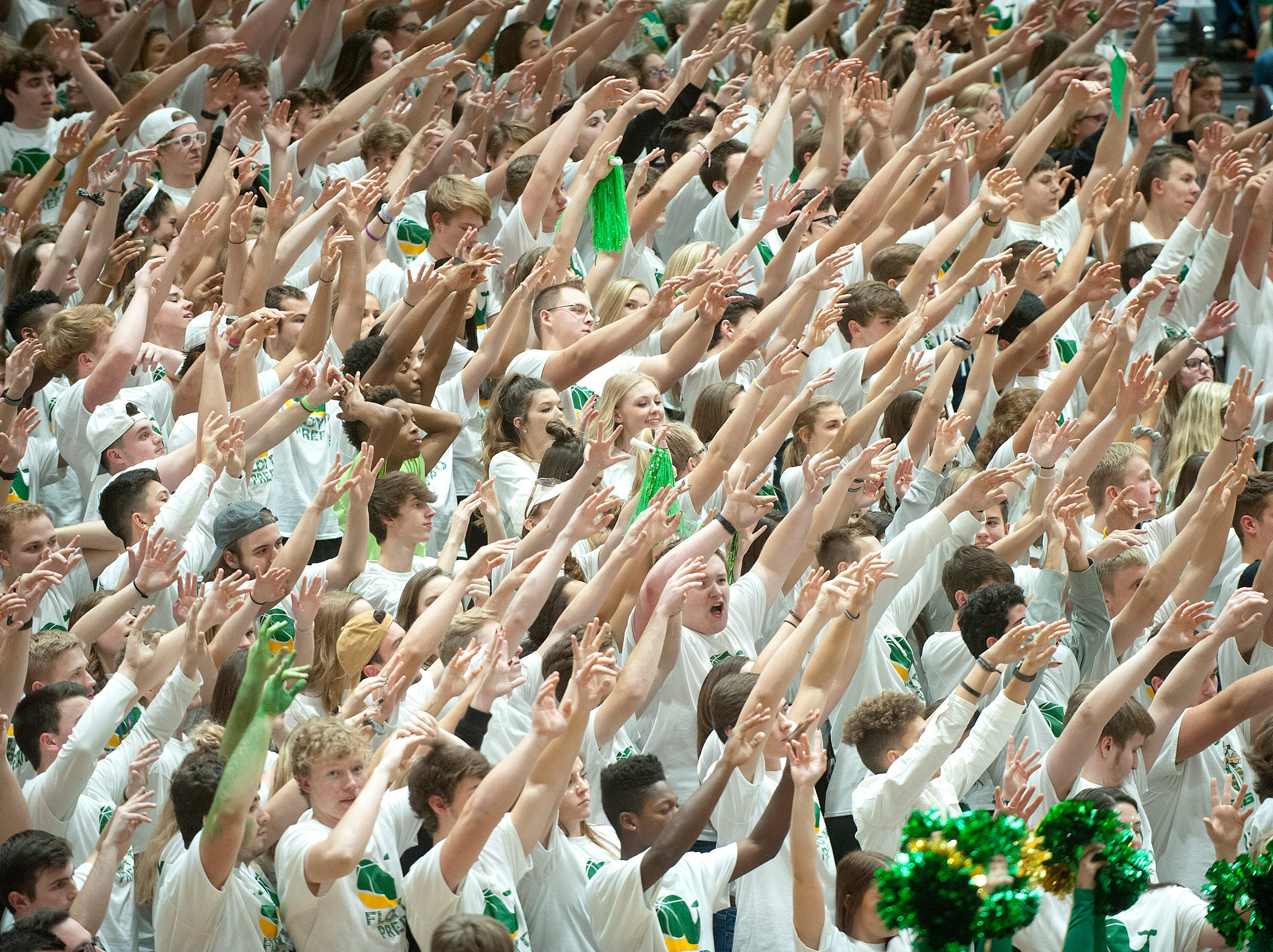 The Floyd Central fans use their hands to give one of their shooters some mojo on the free-throw line.07 December 2018