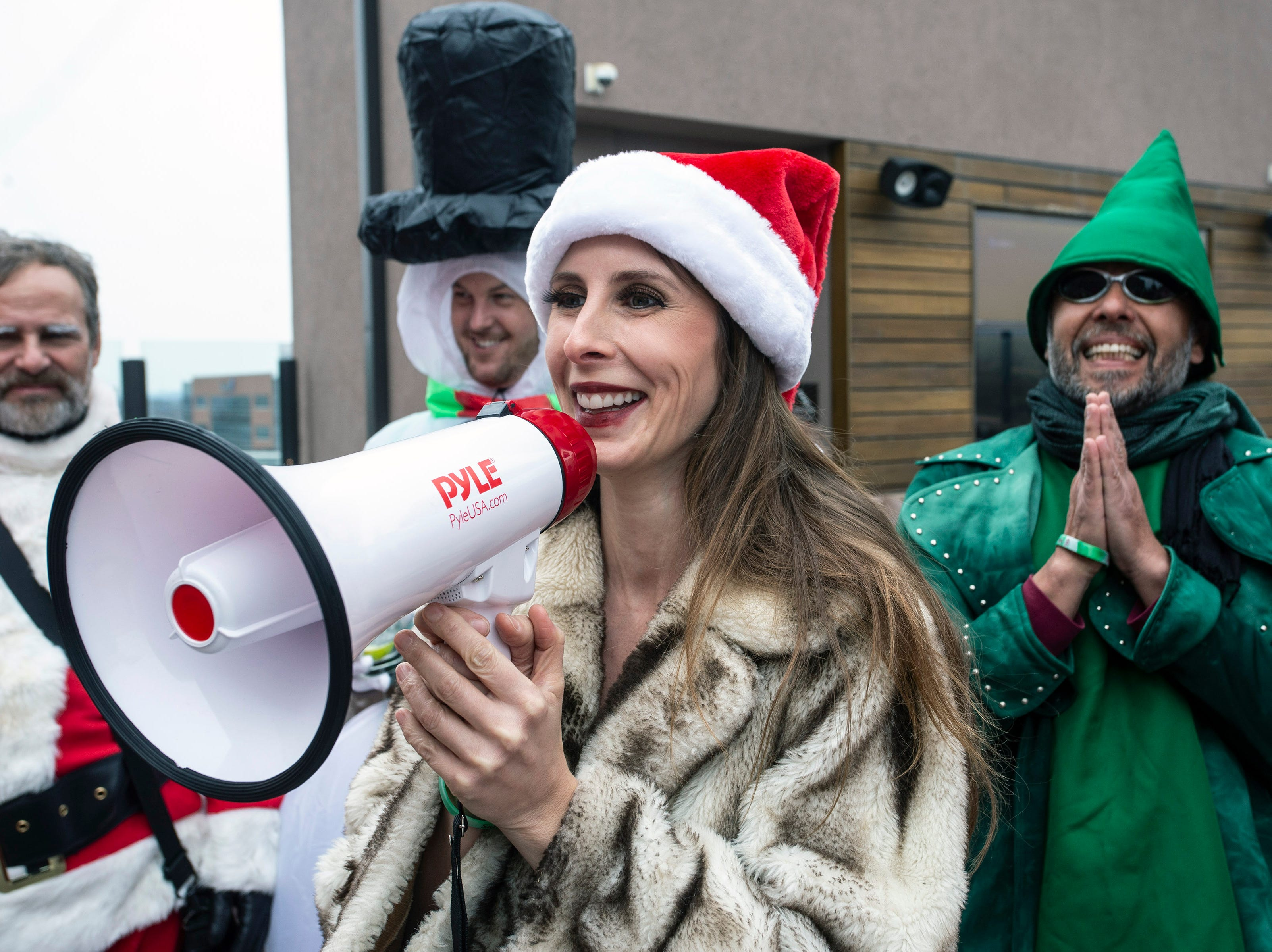 Sammy-Jo Hand guided a group of Santas and other holiday characters through a breathing exercise at the start of SantaCon on Saturday. 12/8/18