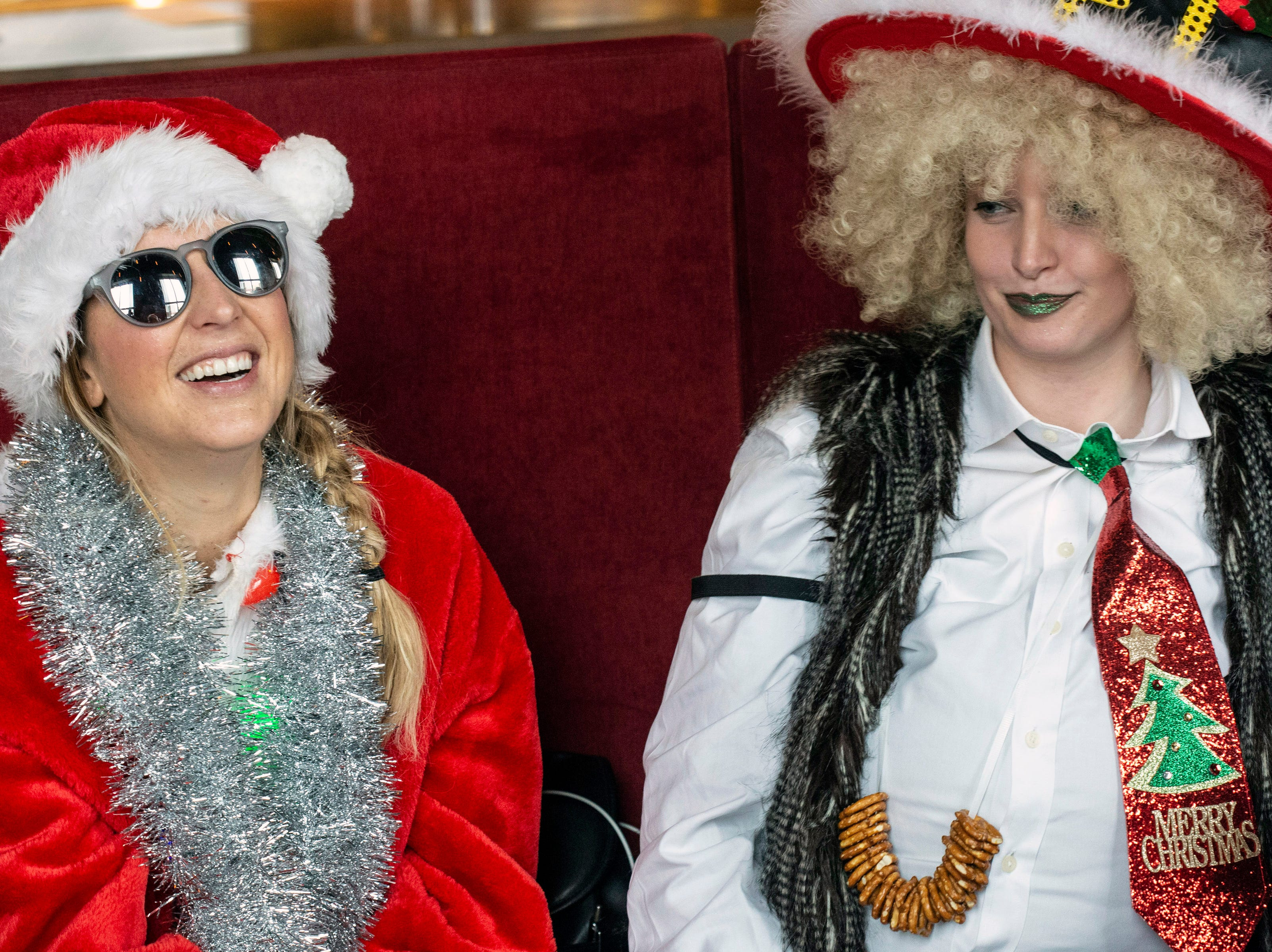 A mix of holiday themed costumes and Santa outfits could be found aplenty at the annual SantaCon on Saturday. 12/8/18