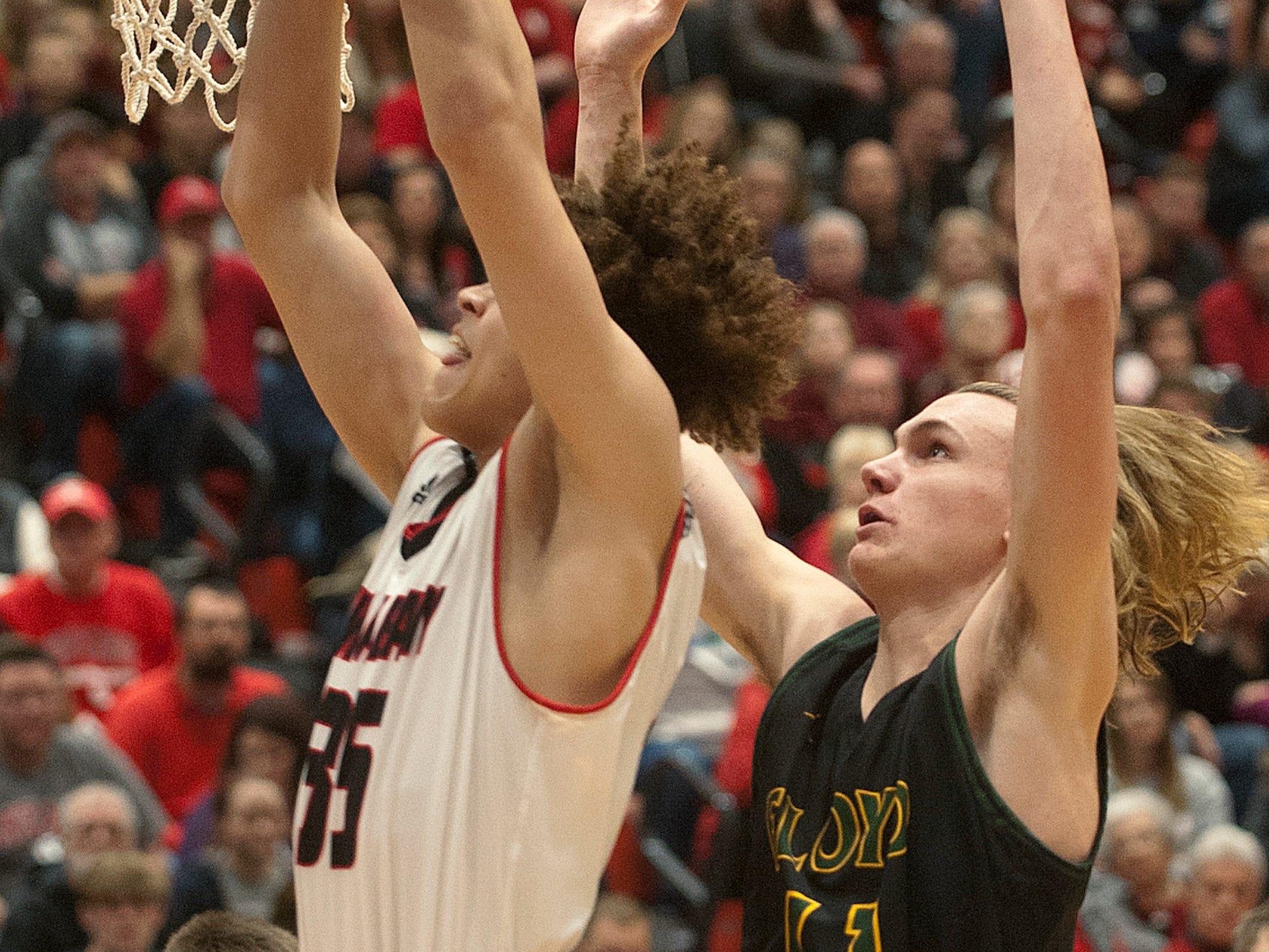 New Albany center Jordan Thomas beats Floyd Central center Logan Libs to the basket.07 December 2018