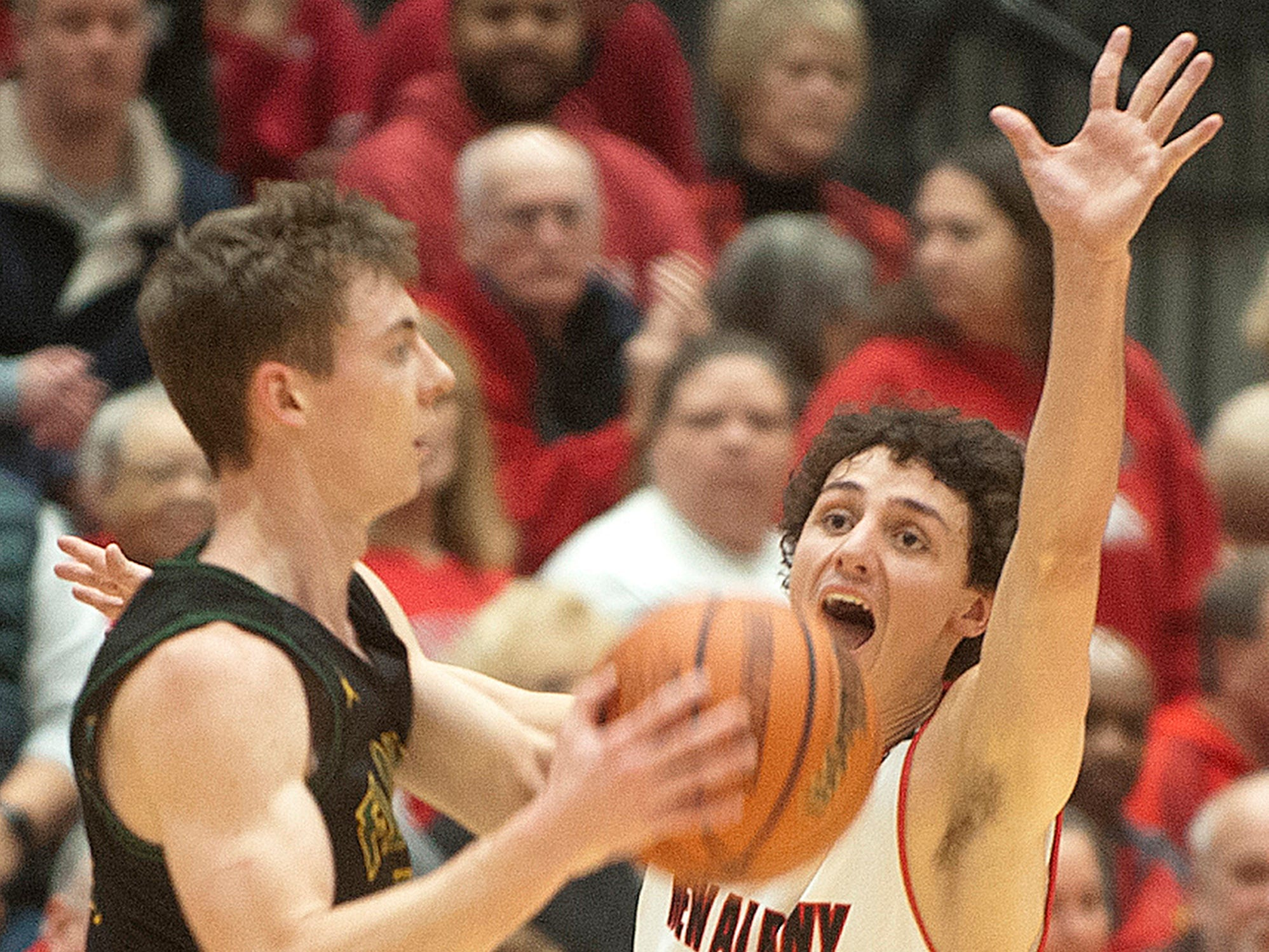 New Albany guard Landon Sprigler tries to block the passing lane as Floyd Central guard Nick Winchell looks to throw the ball.07 December 2018