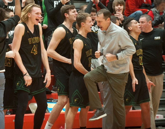 Moments after the end of the game, Floyd Central head basketball coach Todd Sturgeon and the bench react to their 44-37 victory over rival New Albany on New Albany's home court.07 December 2018