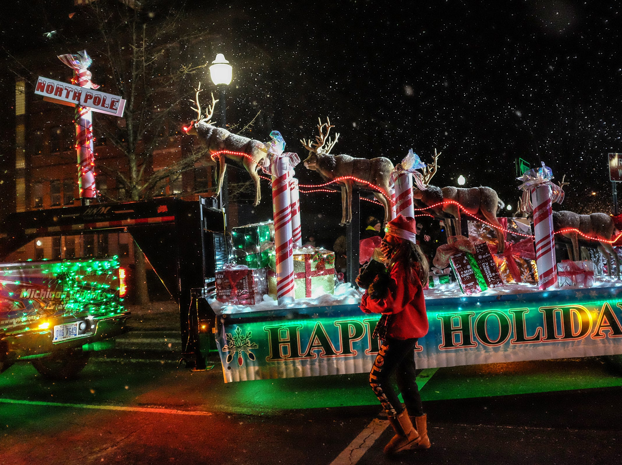 An elaborate float makes its way downtown during the Annual Festival of Lights and Santa Parade in St. Johns Friday, Dec. 7, 2018.