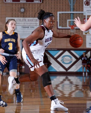 Okemos' Jasmine Clerkley drives against Grand Ledge's Makenzie Todd, Friday, Dec. 7, 2018, in Okemos, Mich.