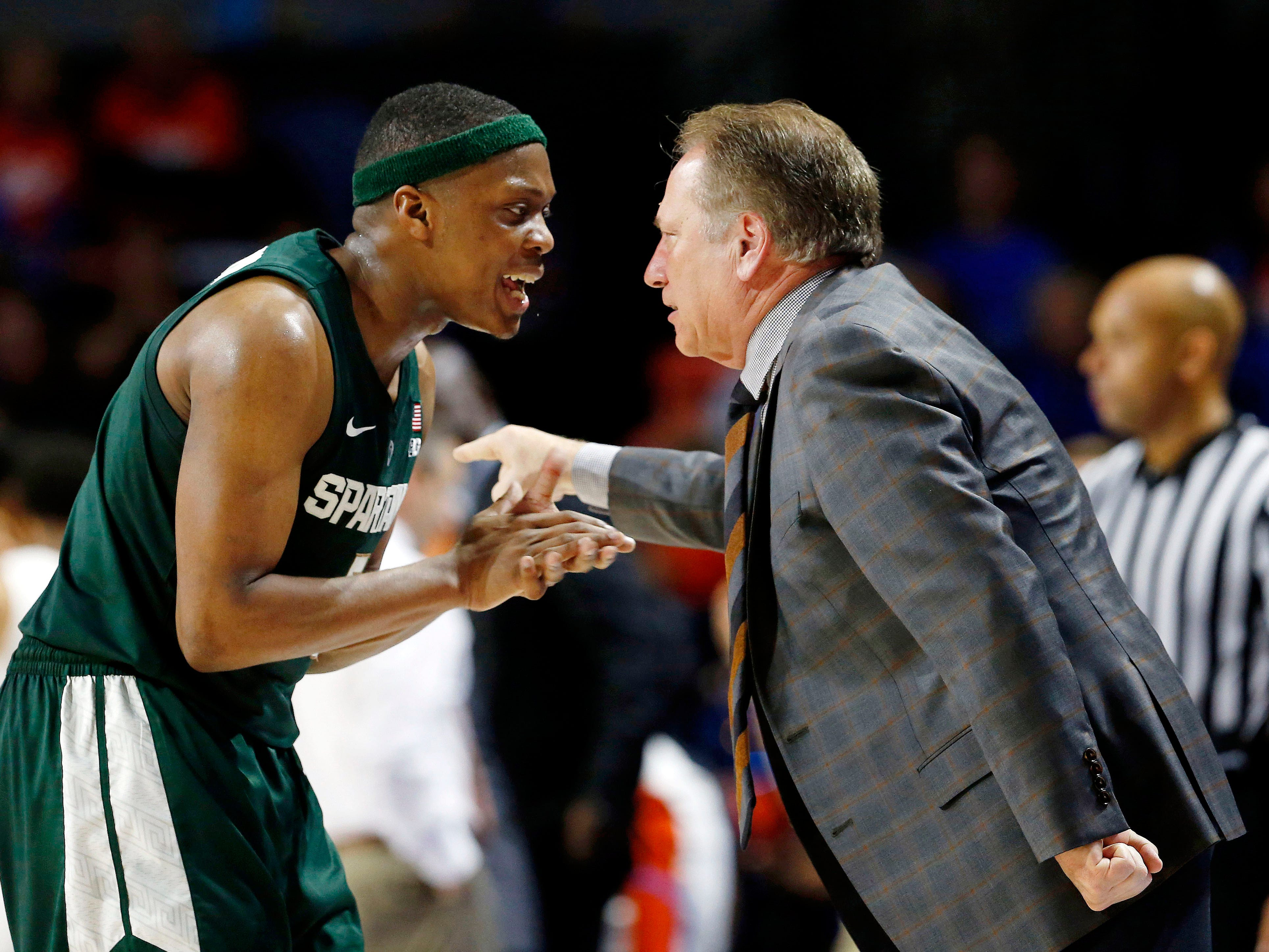 ; Michigan State Spartans guard Cassius Winston (5) and Michigan State Spartans head coach Tom Izzo talk during the second half against the Florida Gators at Exactech Arena.