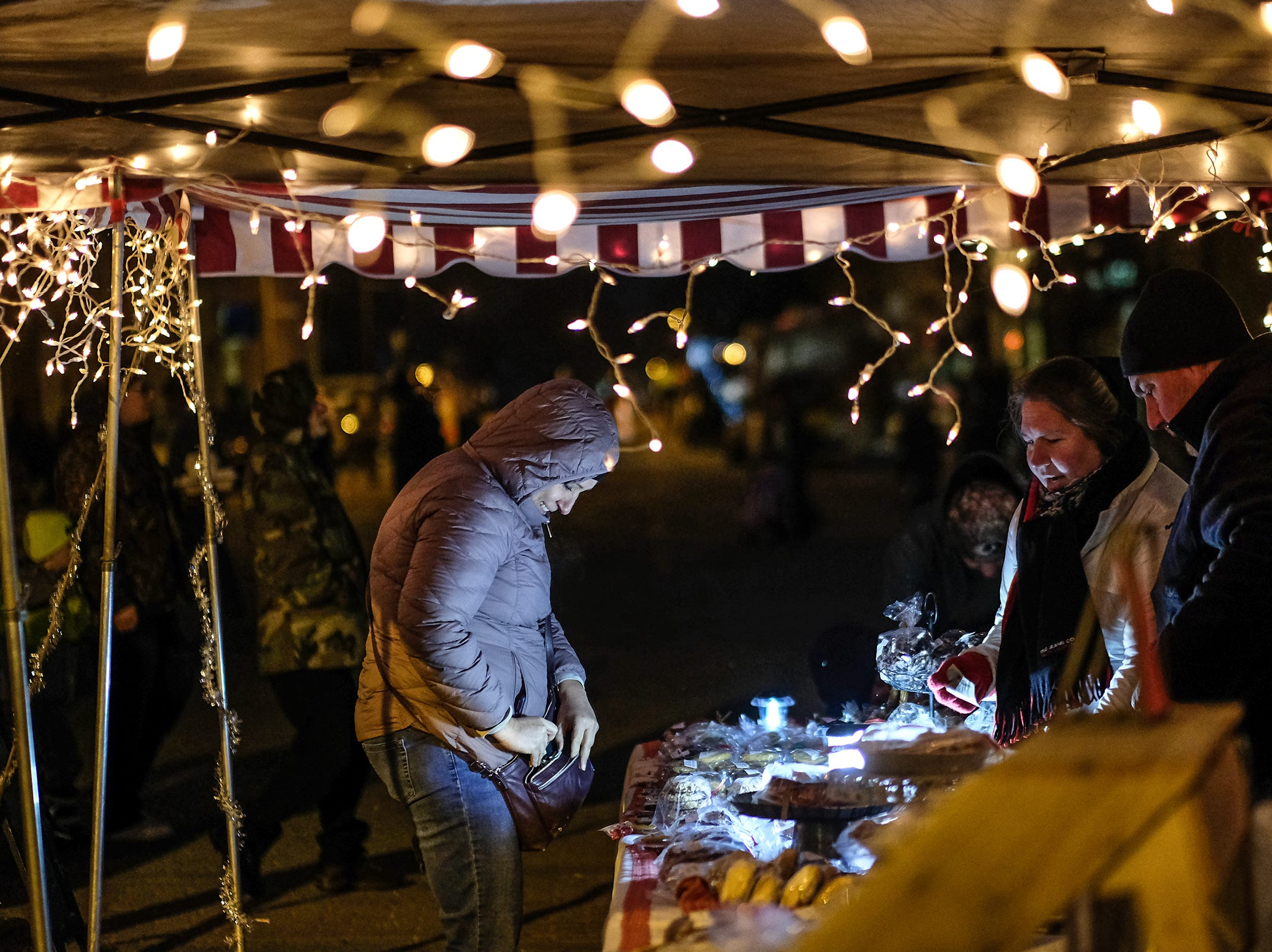 One of the vendors at the Annual Festival of Lights and Santa Parade is The Whisked Away Bakery Friday, Dec. 7, 2018.