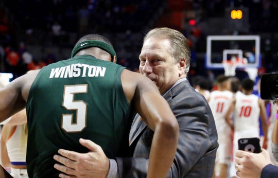 Michigan State Spartans head coach Tom Izzo greets Michigan State Spartans guard Cassius Winston (5) as they beat the Florida Gators at Exactech Arena.