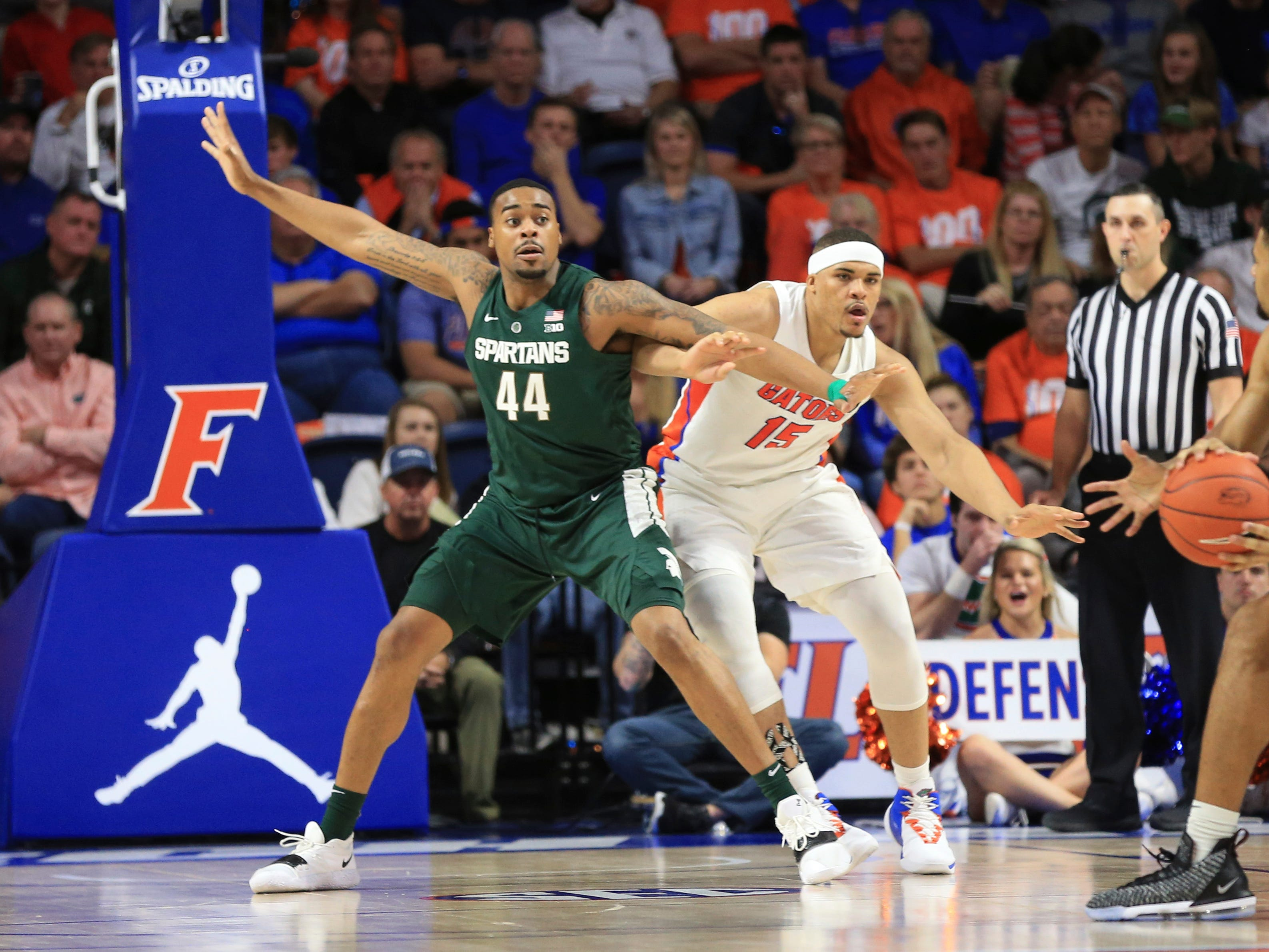 Michigan State forward Nick Ward (44) posts up on Florida forward Isaiah Stokes (15) during the second half of an NCAA college basketball game Saturday, Dec. 8, 2018, in Gainesville, Fla. Michigan State defeated Florida 63-59.