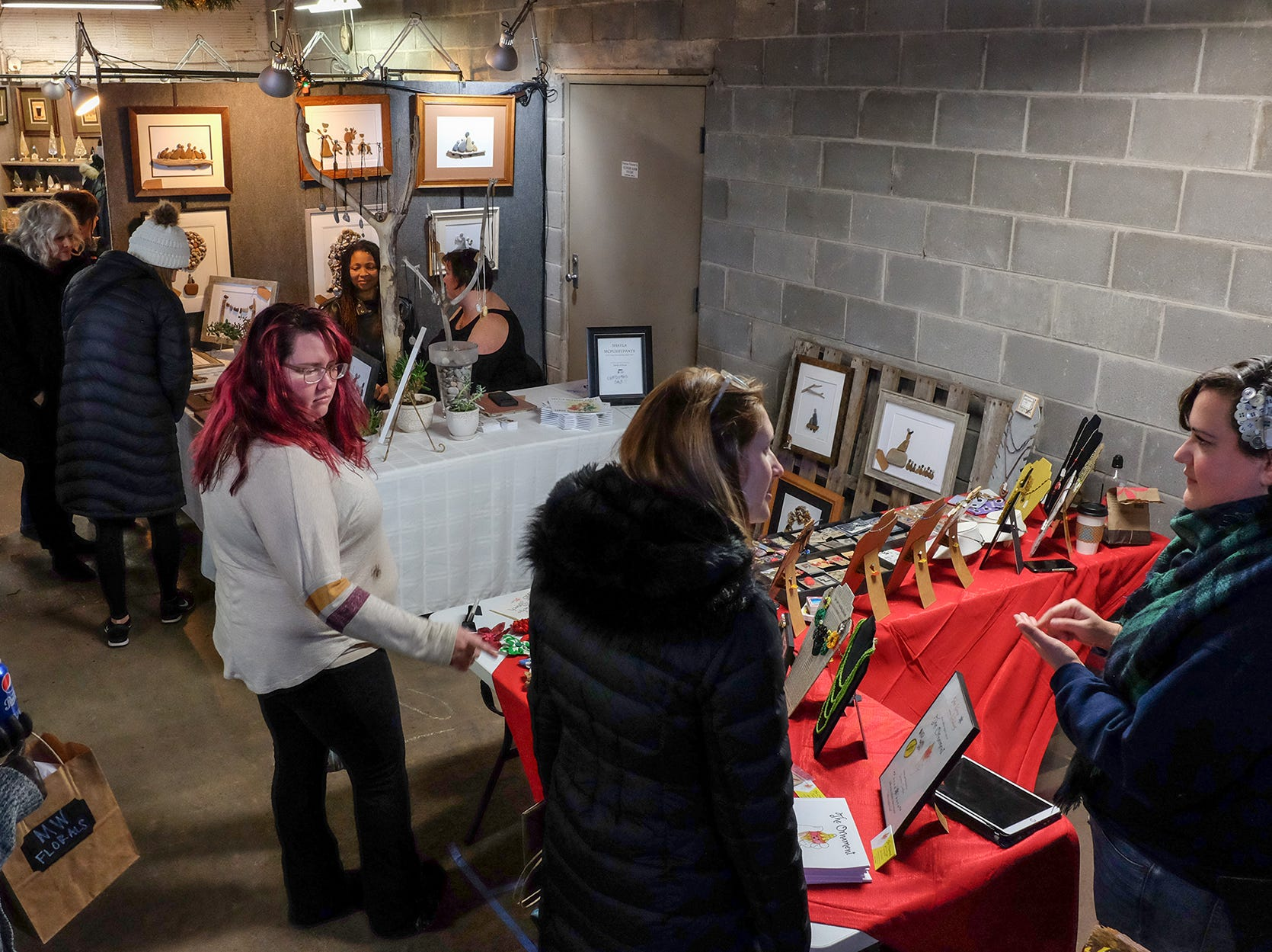 People shop the Reo Town Marketplace Saturday, Dec. 8, 2018.