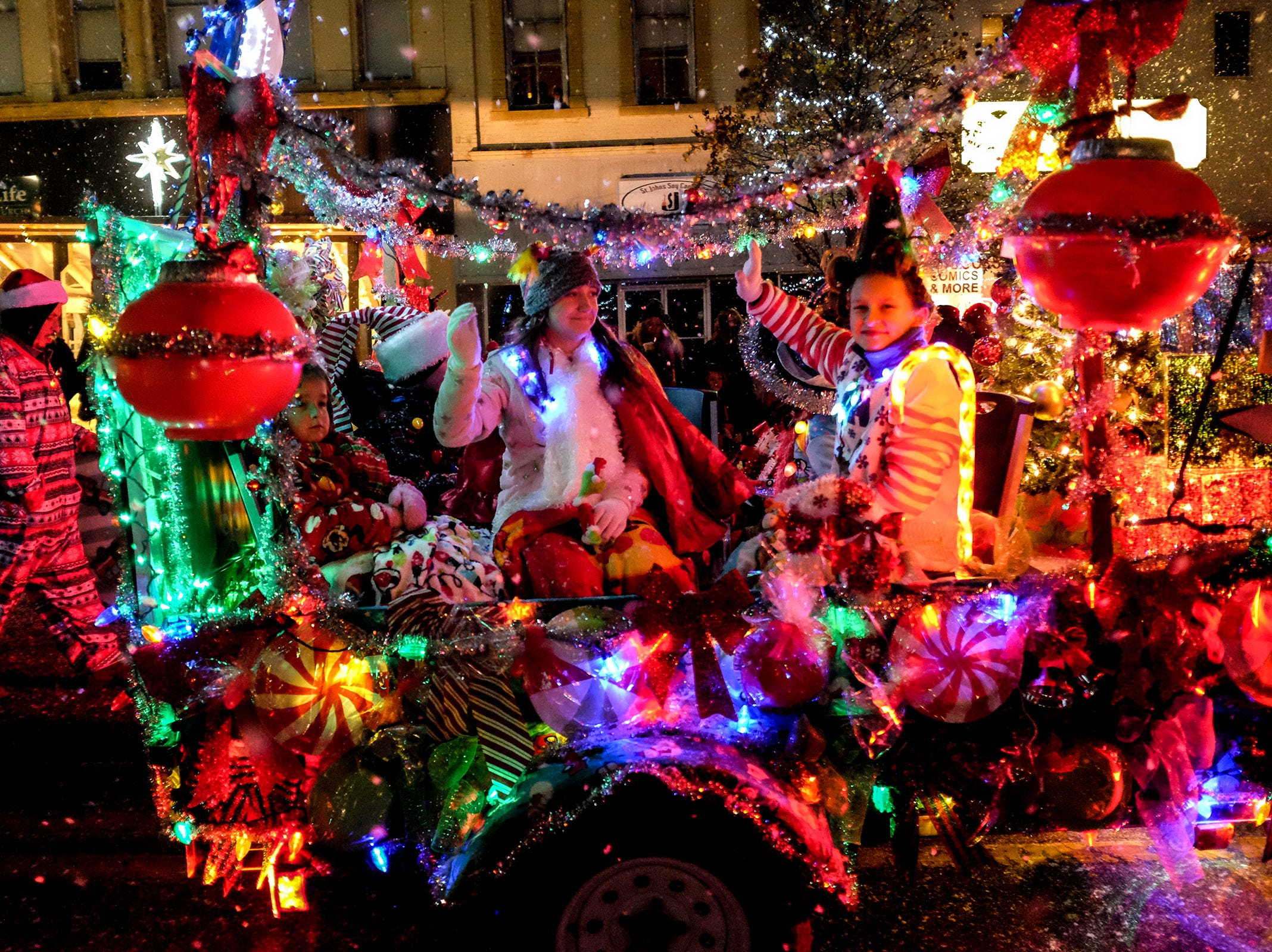 The Annual Festival of Lights and Santa Parade is full of floats with decorations and lights Friday, Dec, 7, 2018.
