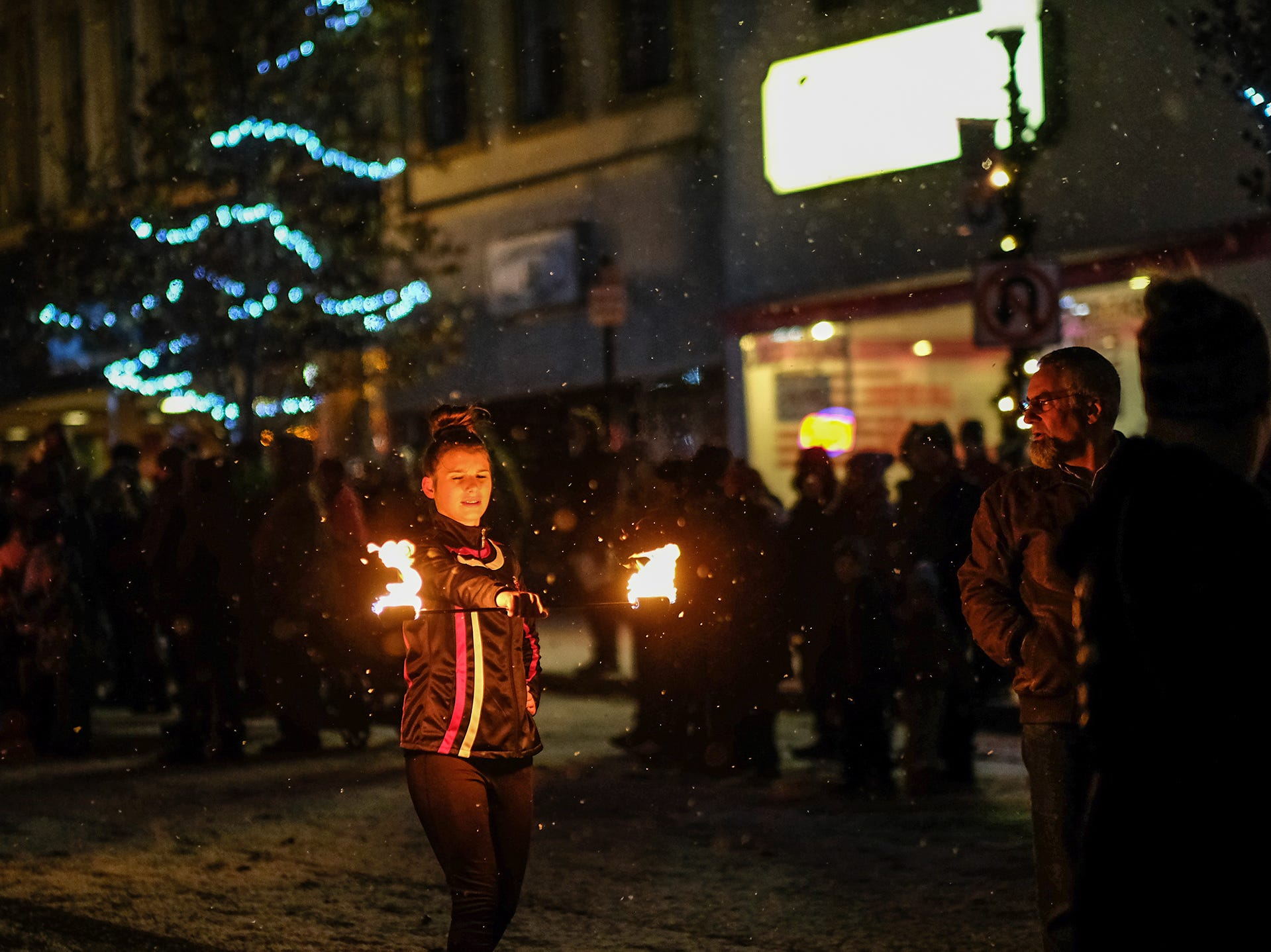 A baton twirler marches in the Annual Festival of Lights and Santa Parade in downtown St. Johns Friday, Dec, 7, 2018.