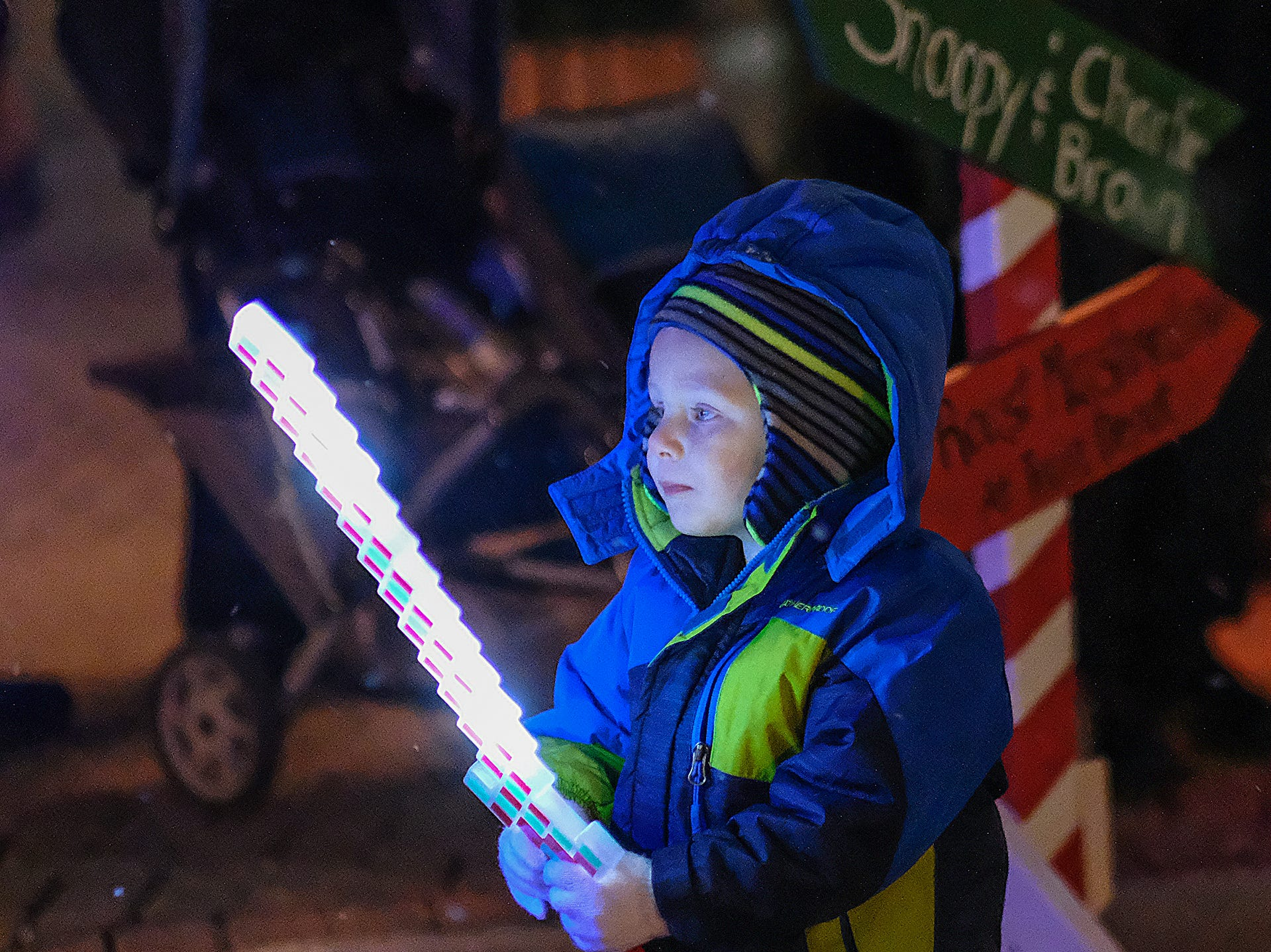 This youngster plays with a lighted sword at the Annual Festival of Lights and Santa Parade in downtown St. Johns Friday, Dec, 7, 2018.