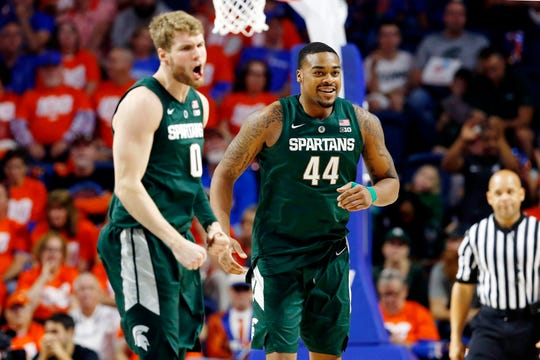 Michigan State Spartans forward Nick Ward (44) and forward Kyle Ahrens (0) celebrate against the Florida Gators during the second half at Exactech Arena.