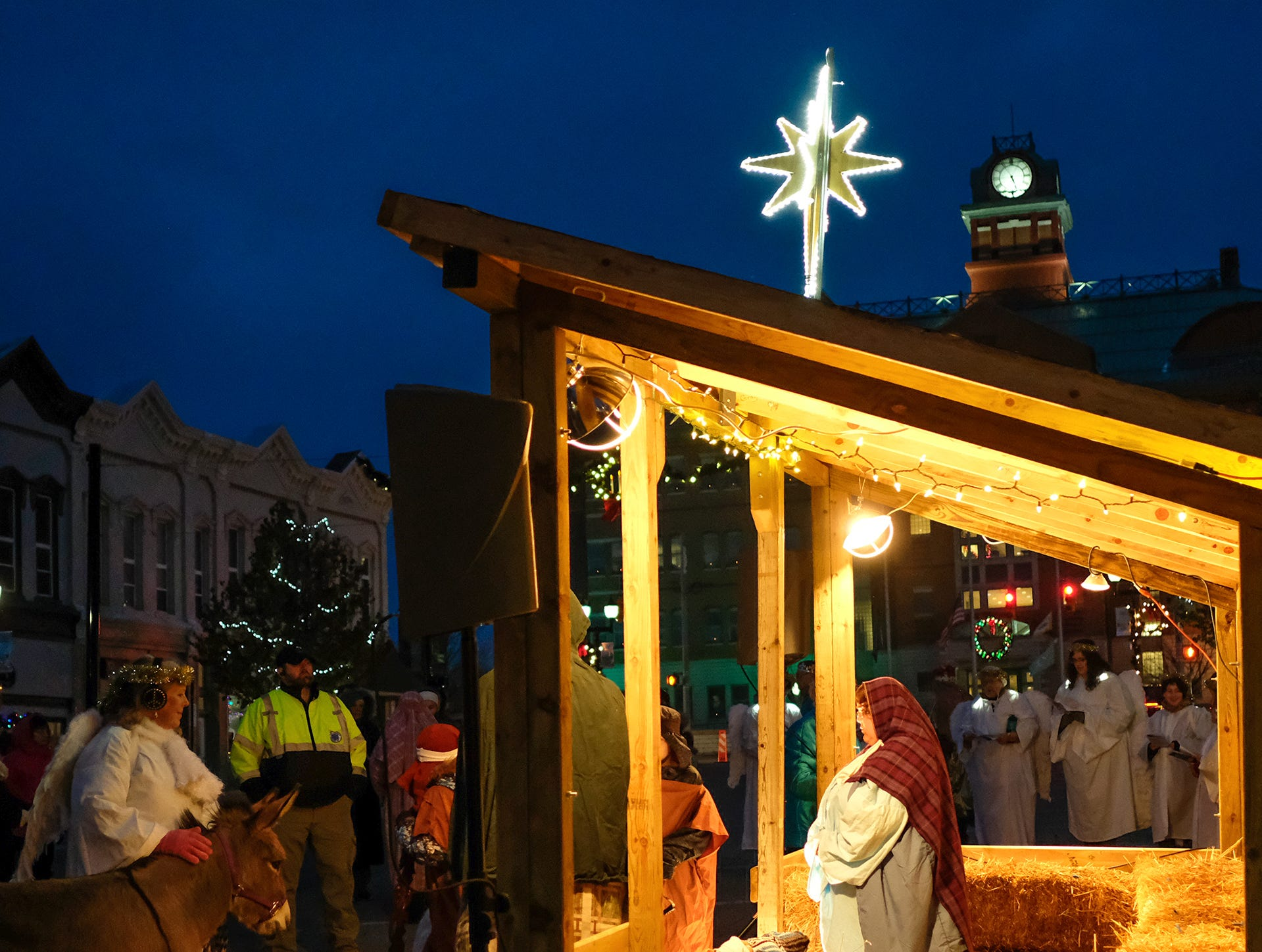 A nativity scene is played out in the Annual Festival of Lights and Santa Parade event in downtown St. Johns Friday, Dec, 7, 2018.