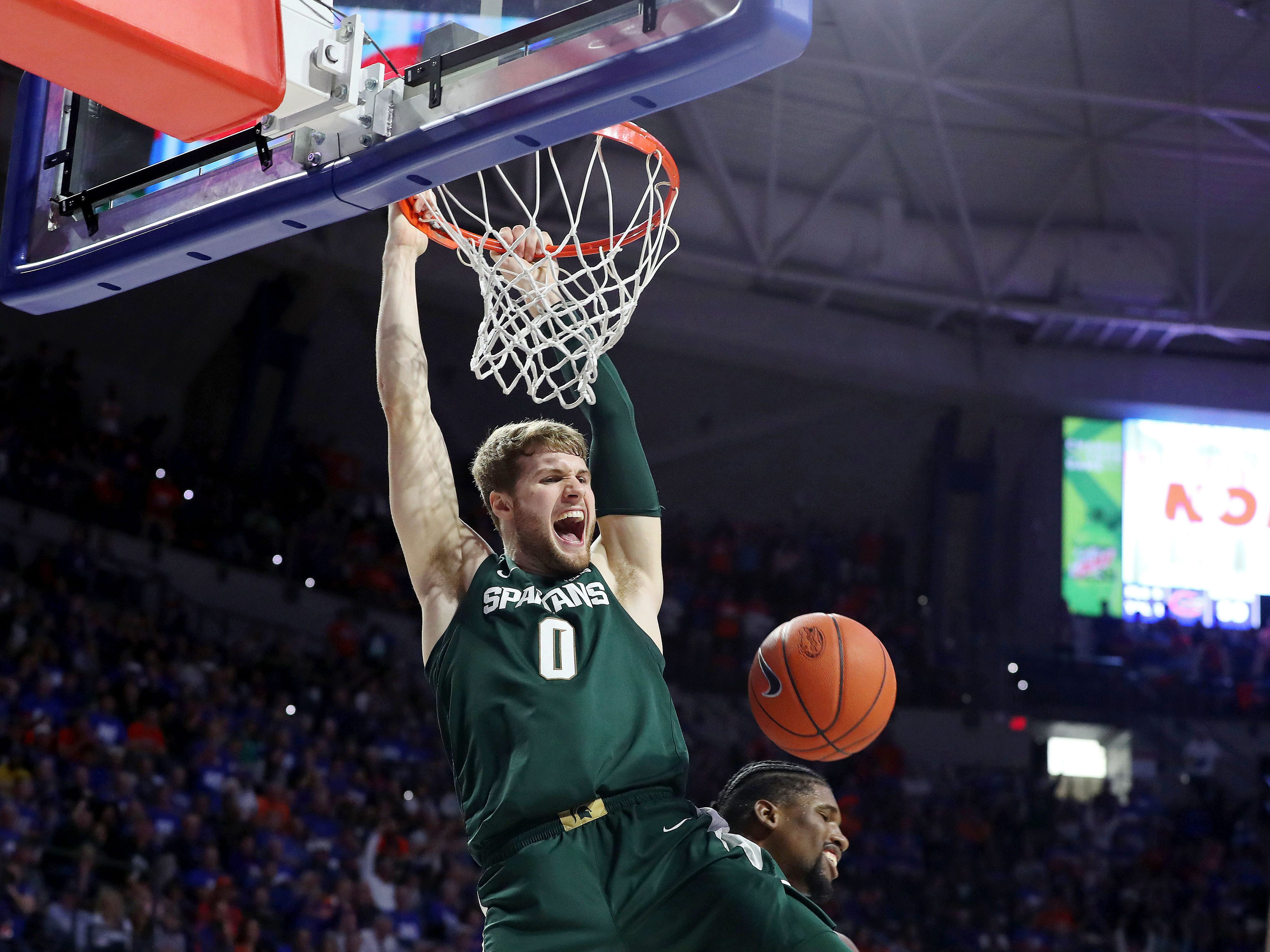 USA;Michigan State Spartans forward Kyle Ahrens (0) celebrates as he dunks against the Florida Gators during the second half at Exactech Arena.