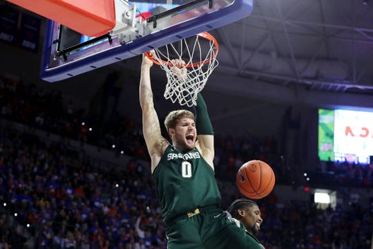Kyle Ahrens celebrates as he dunks in the final seconds against Florida on Dec. 8, securing MSU's victory.