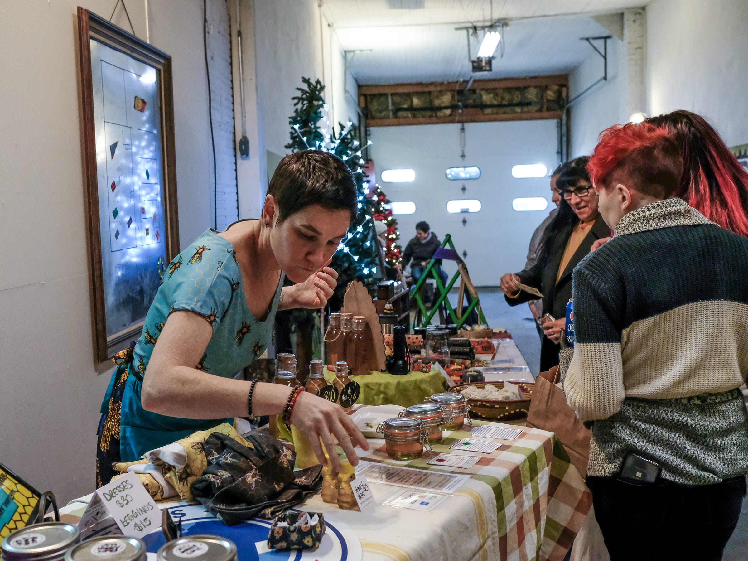 Pop-up vendors are set up in any space available at the Reo Town Marketplace Saturday, Dec. 8, 2018.