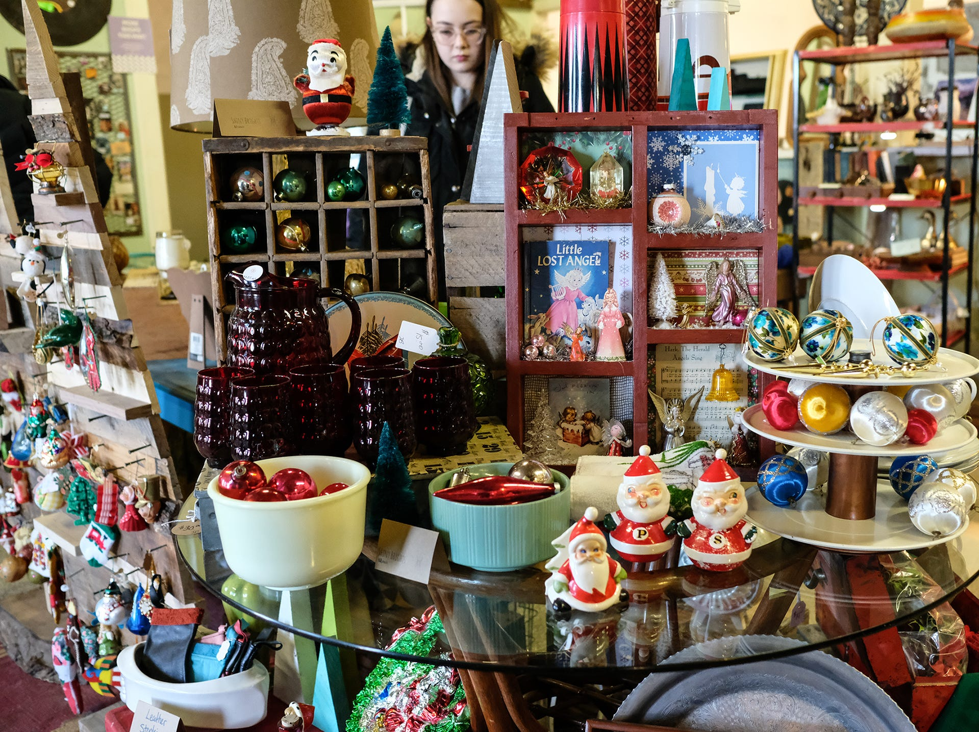 There are lots of unique Christmas ornaments on display at Vintage Junkies and other vendors at the Reo Town Marketplace Saturday, Dec. 8, 2018.
