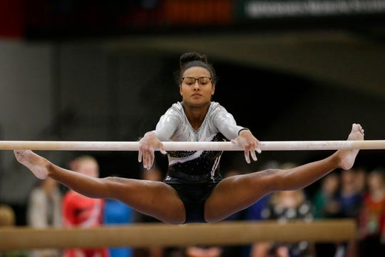 Valders/Roncalli's Whitney Andrastek performs on the uneven bars during the Manitowoc Holiday Gymnastics Invitational.