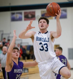 Roncalli's David Heinzen drives to the hoop against Kiel during an Eastern Wisconsin Conference game at Roncalli Friday in Manitowoc.
