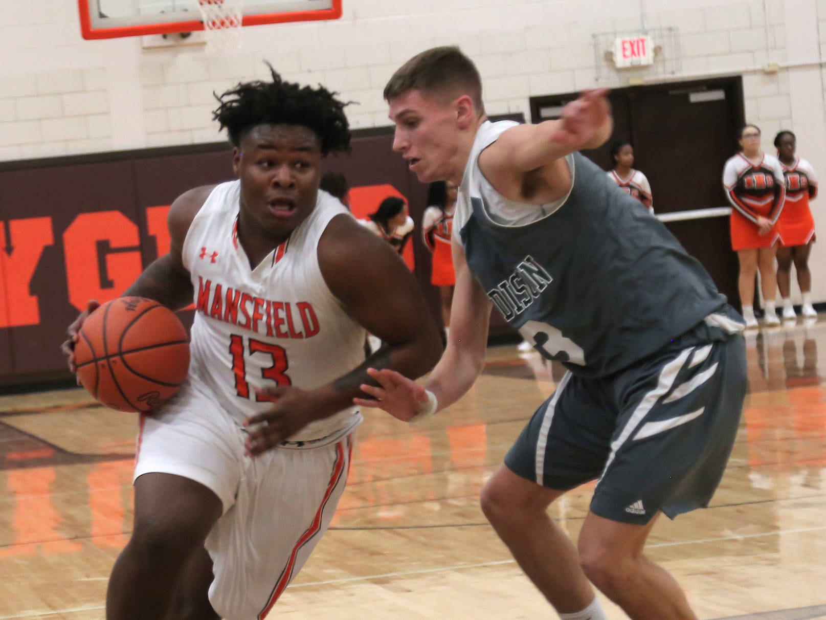 Mansfield Senior's Quan Hilory dribbles the ball against Madison's Dylan Metz at Malabar Middle School on Friday Night.