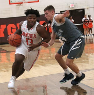 Mansfield Senior's Quan Hilory, shown here in Friday's win over Madison, scored a career-high 30 points Saturday night as the Tygers knocked off Columbus Northland for a clean sweep of the weekend.