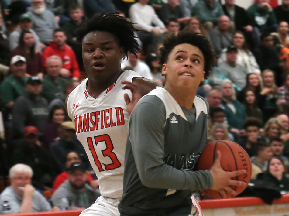Madison's Jayondrae Jones attempts a jump shot against Mansfield Senior's Quan Hilory at Malabar Middle School on Friday Night.