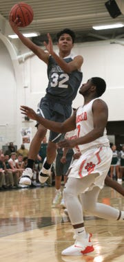 Madison's Isaac Brooks makes a jump shot at Malabar Middle School on Friday Night.