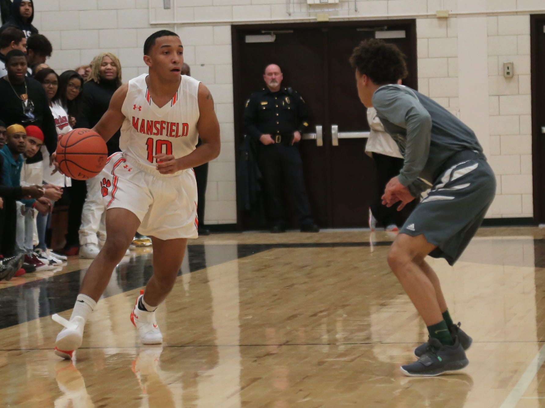 Mansfield Senior's Cameron Todd dribbles the ball  at Malabar Middle School on Friday Night.