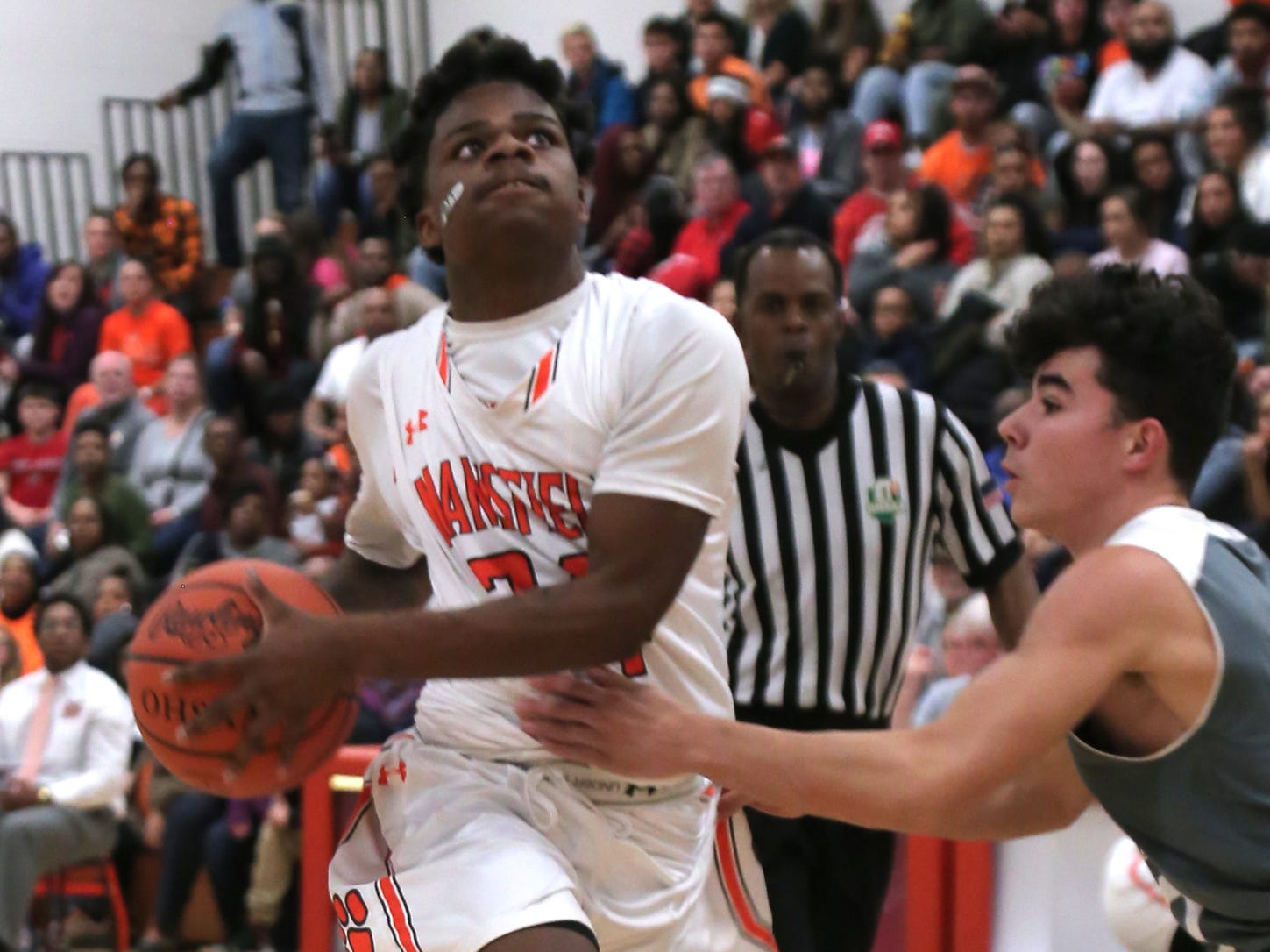Mansfield Senior's Angelo Grose attempts a jump shot at Malabar Middle School on Friday Night.