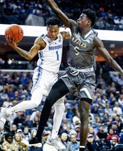 Memphis guard Tyler Harris (left) is fouled by UAB defender during action at the FedExForum in Memphis, Tenn., Saturday December 8, 2018