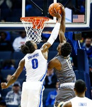 Memphis Memphis forward Kyvon Davenport (right) blocks the shot of UAB forward Will Butler (left) during action at the FedExForum in Memphis, Tenn., Saturday December 8, 2018
