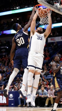 Memphis Grizzlies center Marc Gasol (33) dunks the ball over New Orleans Pelicans forward Julius Randle (30) in the first half of an NBA basketball game in New Orleans, Friday, Dec. 7, 2018. (AP Photo/Tyler Kaufman)