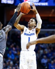Memphis guard Tyler Harris hits a 3-pointer against the UAB defense during action at the FedExForum in Memphis, Tenn., Saturday December 8, 2018