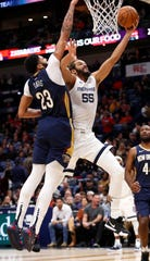Memphis Grizzlies center Joakim Noah (55) shoots over New Orleans Pelicans forward Anthony Davis (23) in the first half of their game in New Orleans on Friday.