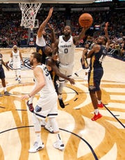 Memphis Grizzlies forward JaMychal Green (0) shoots over New Orleans Pelicans forward Julius Randle (30) in the second half of an NBA basketball game in New Orleans, Friday, Dec. 7, 2018. (AP Photo/Tyler Kaufman)