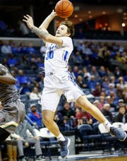 Memphis guard Evin Olds is fouled while driving to the basket against UAB last season.