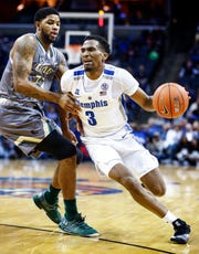 Memphis guard Jeremiah Martin (right) drives to the basket against UAB defender Lewis Sullivan  (left) during action at the FedExForum in Memphis, Tenn., Saturday December 8, 2018