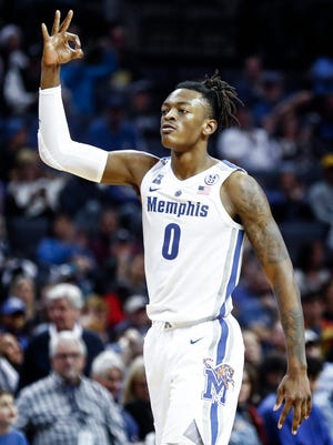 Memphis forward Kyvon Davenport celebrates a made 3-pointer against UAB during action at the FedExForum in Memphis, Tenn., Saturday December 8, 2018
