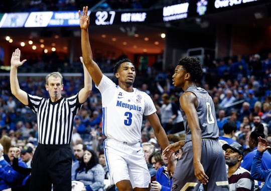 Memphis guard Jeremiah Martin (middle) celebrates a made 3-pointer against UAB during action at the FedExForum in Memphis, Tenn., Saturday December 8, 2018