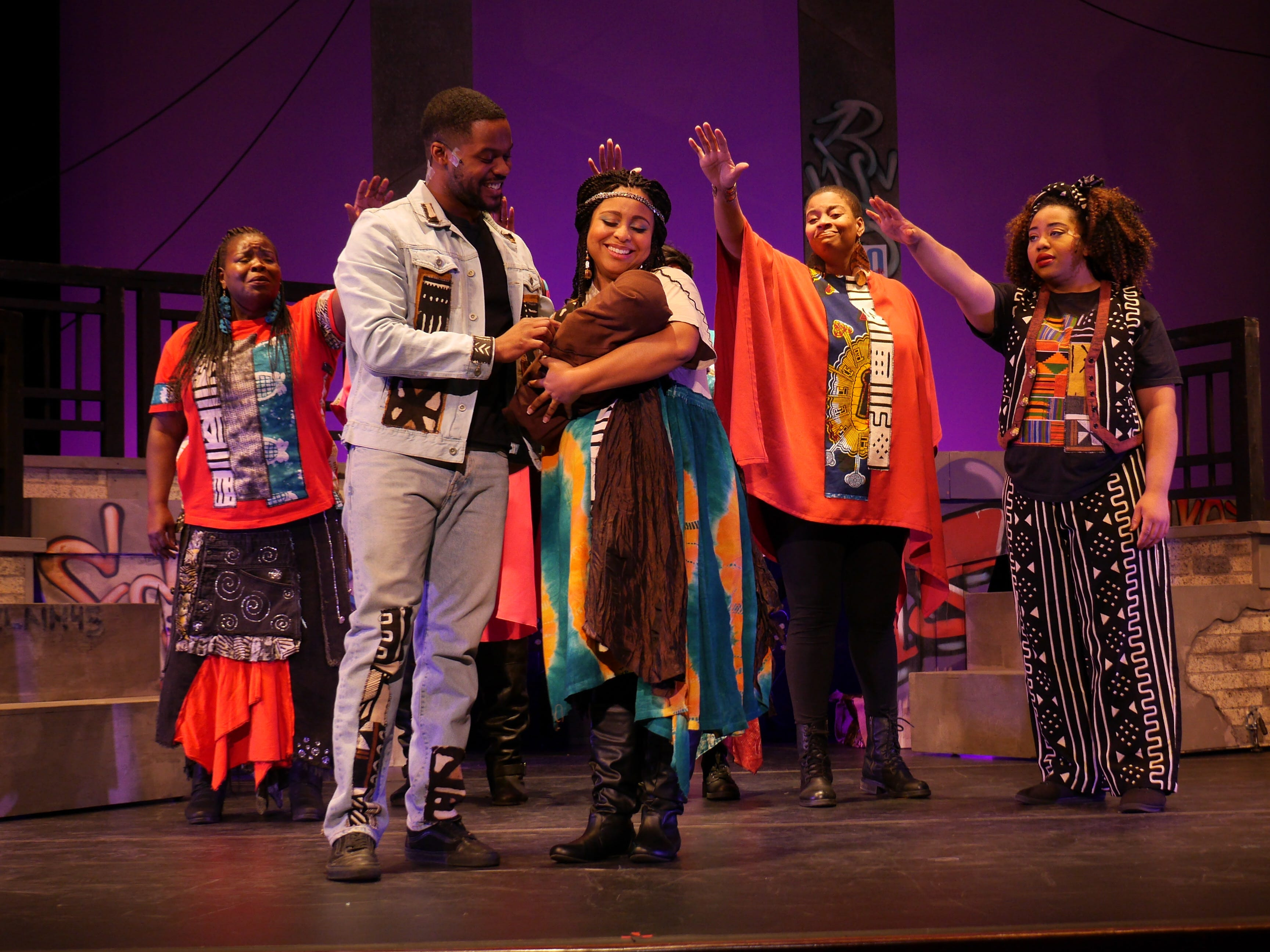 "Women of the community bless Joseph (Di'monte Henning), Mary (Natalie Harris) and the baby Jesus in ""Black Nativity,"" performed by Bronzeville Arts Ensemble at the Marcus Center."