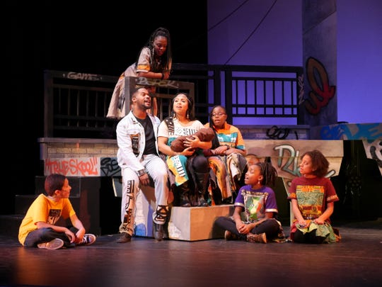 """Children celebrate the baby Jesus with Joseph (Di'monte Henning) and Mary (Natalie Harris) in """"Black Nativity,"""" performed by Bronzeville Arts Ensemble."""