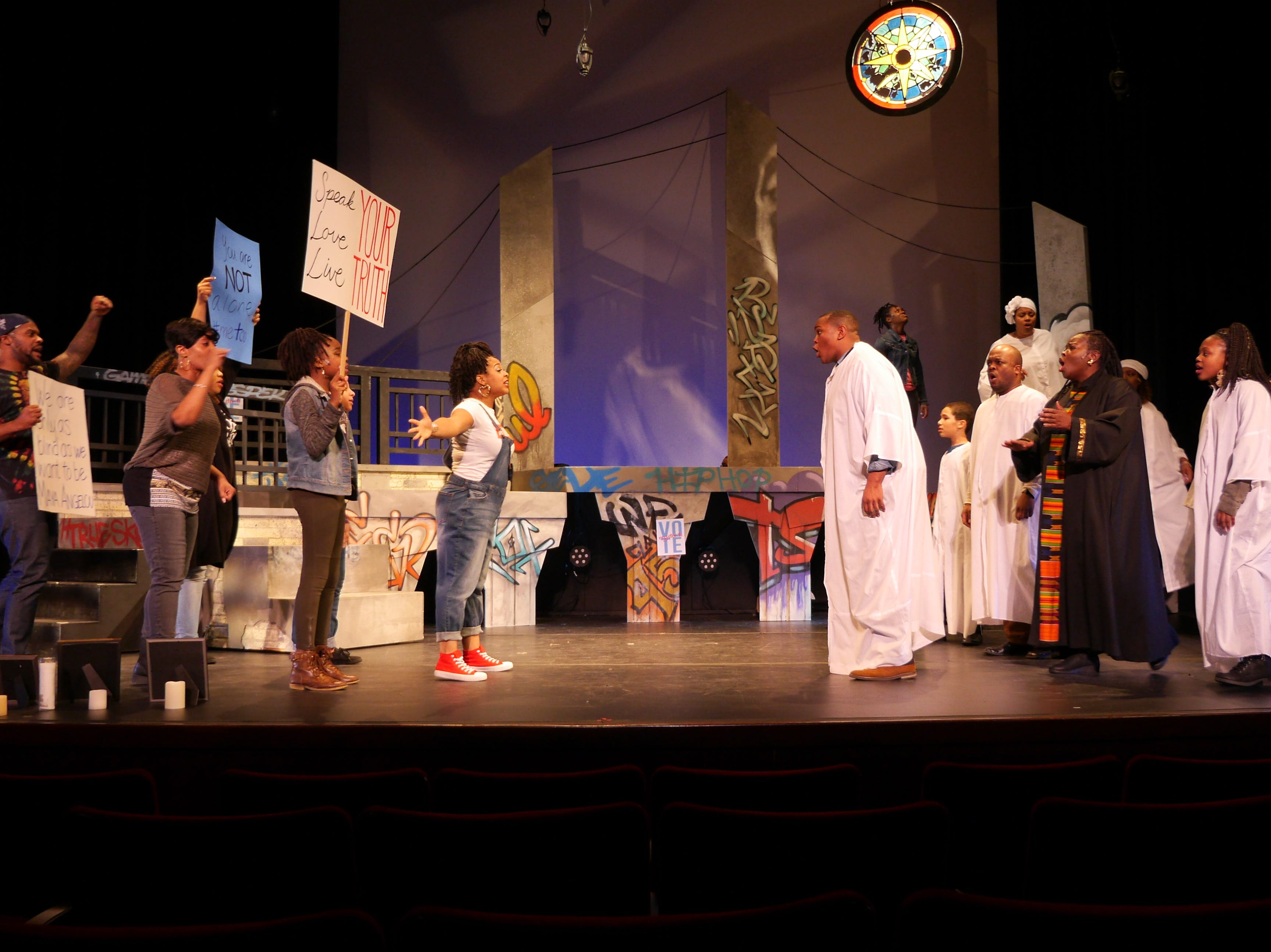 "Activists face church members in ""Black Nativity,"" performed by Bronzeville Arts Ensemble."