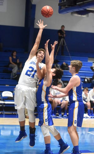Cotter's Cole Adams puts up a shot from the baseline during the Warriors' 47-38 victory over Decatur on Friday night.