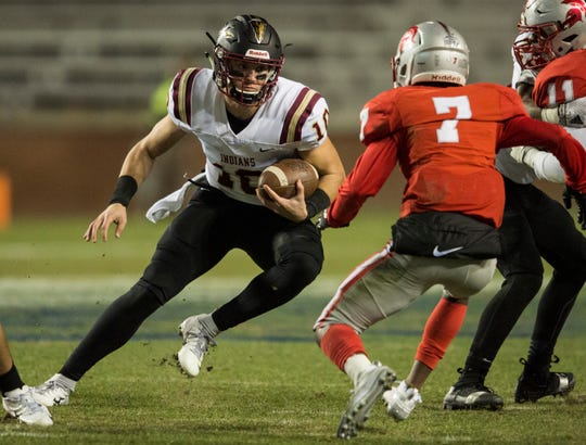 Pinson Valley's Bo Nix (10) runs the ball up the middle during the Class 6A state championship at Jordan-Hare Stadium in Auburn, Ala., on Friday, Dec. 7, 2018. Pinson Valley leads Saraland 12-3 at halftime.