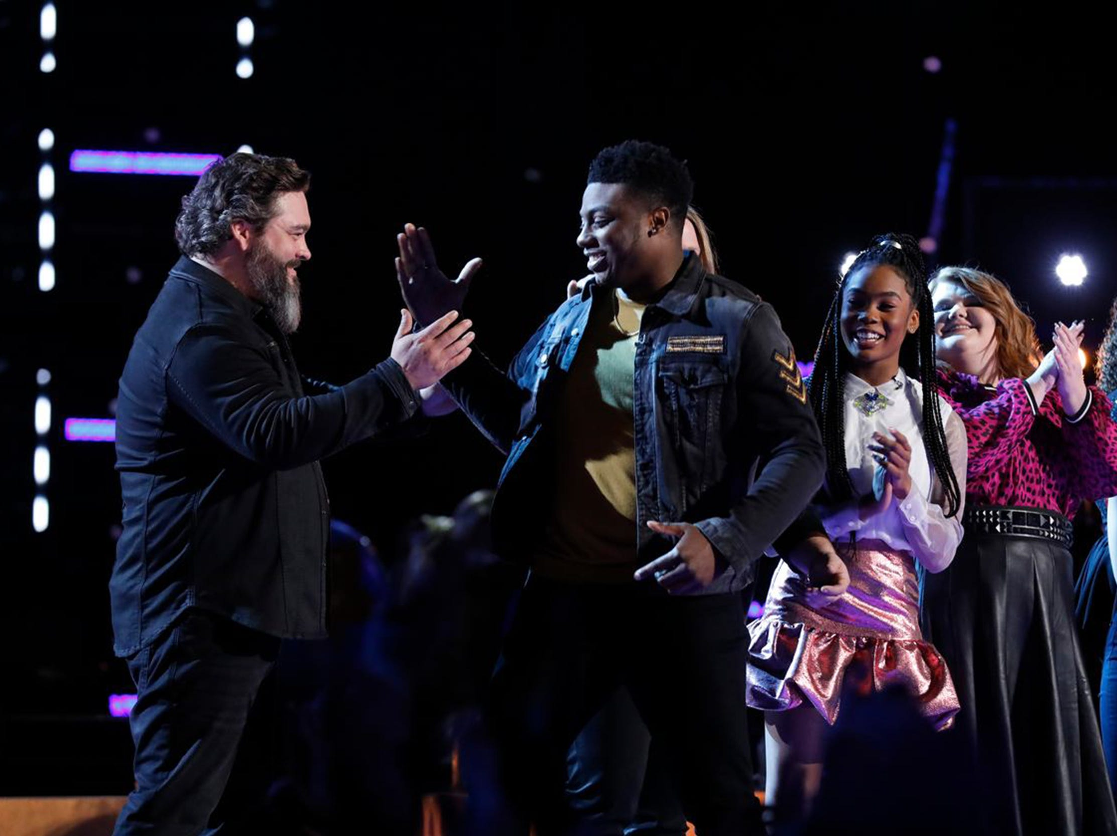 "Team Blake members Dave Fenley, left, and Montgomery singer Kirk Jay celebrate after Jay was named safe Tuesday, Dec. 4, 2018, on NBC's ""The Voice."""
