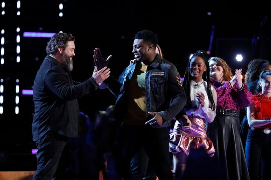 """Team Blake members Dave Fenley, left, and Montgomery singer Kirk Jay celebrate after Jay was named safe Tuesday, Dec. 4, 2018, on NBC's """"The Voice."""""""