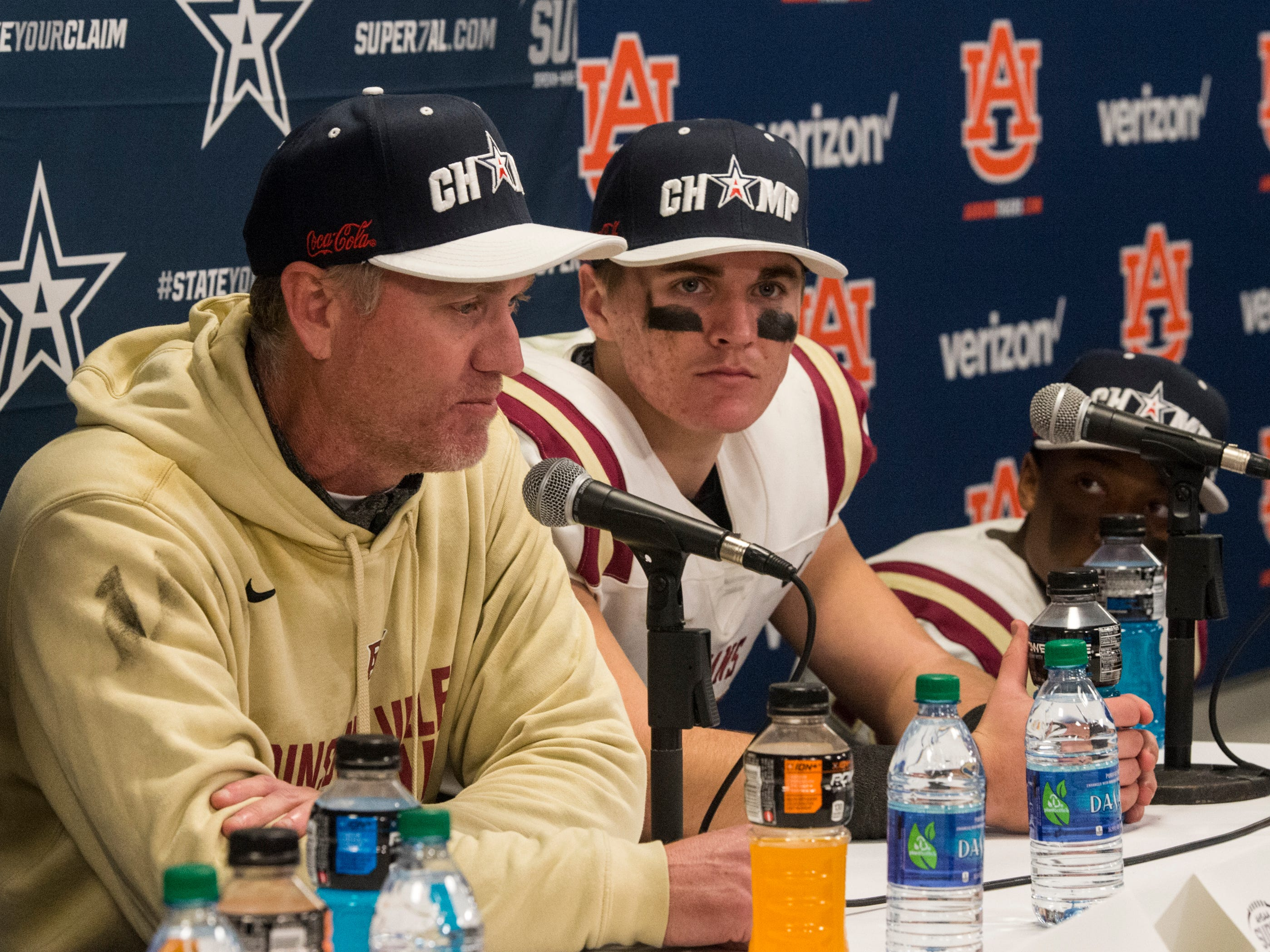 Pinson Valley coach Patrick Nix and his son quarterback Bo Nix (10) talk during the press conference during the Class 6A state championship at Jordan-Hare Stadium in Auburn, Ala., on Friday, Dec. 7, 2018. Pinson Valley defeated Saraland 26-17.