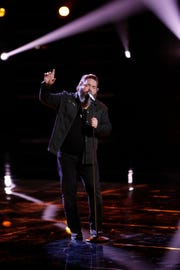 Team Blake member Dave Fenley sings as one of the bottom three performers on Tuesday, Dec. 4, 2018.